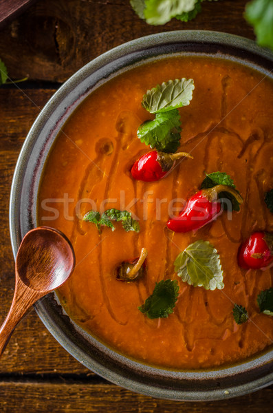 Delish tomato soup with bread and chilli Stock photo © Peteer