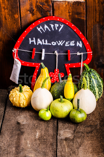 Halloween still life of pumpkins, inscription, shadows Stock photo © Peteer