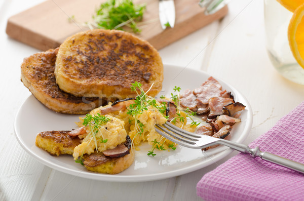 Scrambled eggs with French toast topped with watercress Scrambled eggs with watercress, french toast Stock photo © Peteer