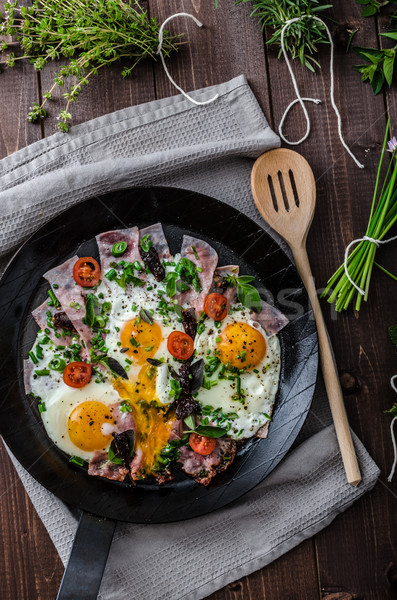 Fried eggs with ham and herbs Stock photo © Peteer