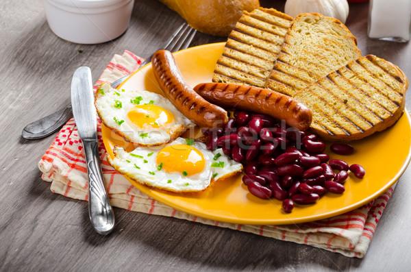 English breakfast - garlic toast, fried egg, beans and English breakfast, toast, egg, beans, sausage Stock photo © Peteer
