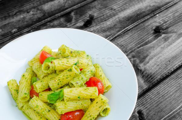 Rigatoni pasta with genoese pesto and sherry tomato Stock photo © Peteer