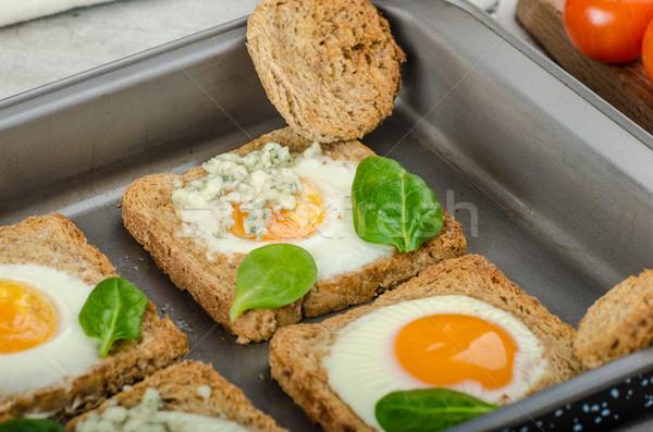 Baked Bull's-Eye Eggs Stock photo © Peteer
