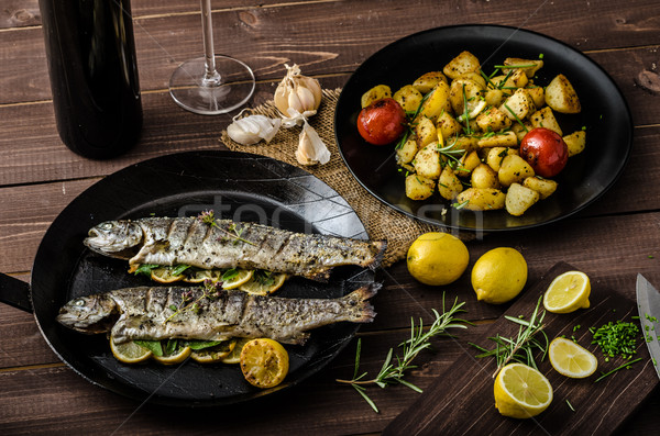 Grilled trout with roasted potatoes Stock photo © Peteer