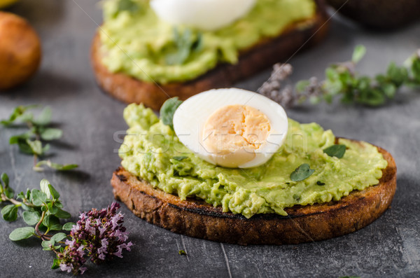 Bio avocado on bread with boiled egg Stock photo © Peteer