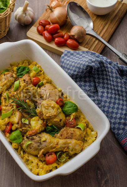 Roasted chicken quarters with curry vegetables Stock photo © Peteer