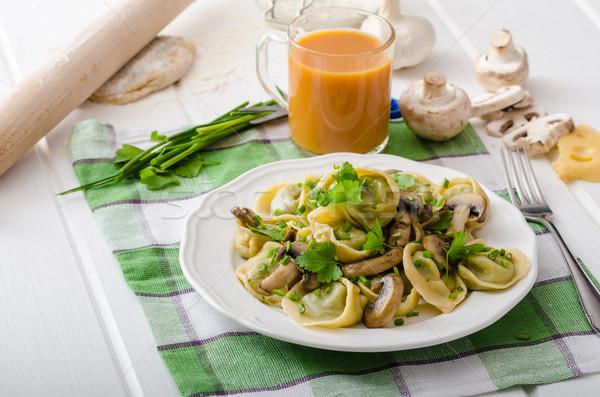 Homemade tortellini with mushrooms and herbs Stock photo © Peteer