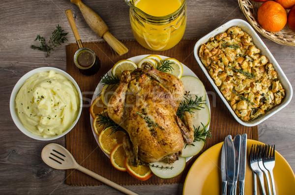 Feasting - stuffed roast chicken with herbs Stock photo © Peteer