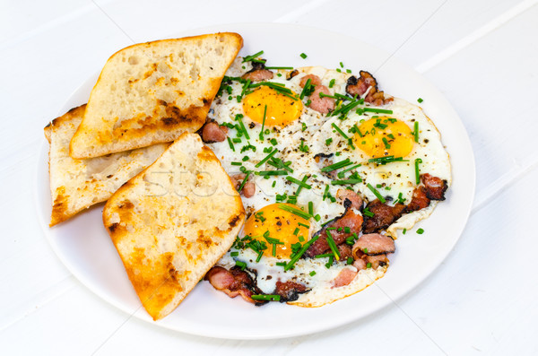 Bacon, eggs and chive with crispy toast Stock photo © Peteer