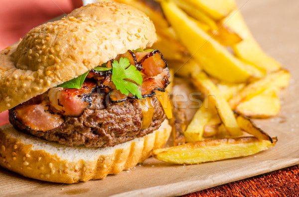Beef burger with bacon, cheddar, homemade fries Stock photo © Peteer