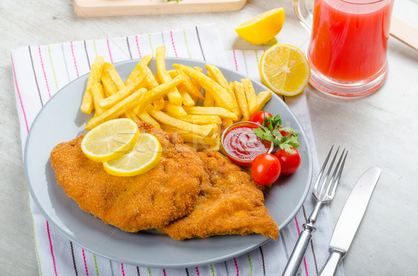 Schnitzel with french fries and a spicy dip Stock photo © Peteer