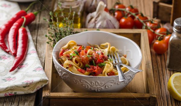 Pasta with cherry tomatoes pesto Stock photo © Peteer
