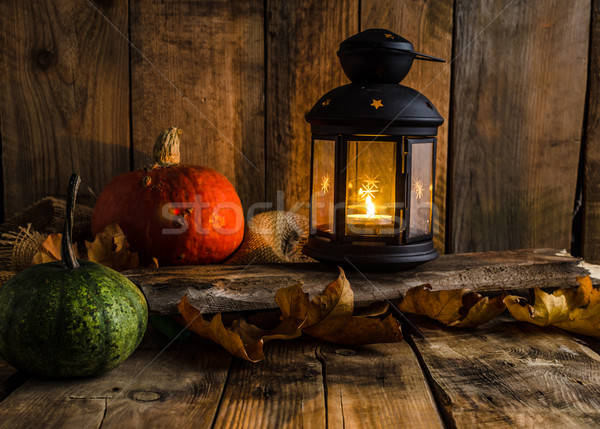 Halloween pumpkin moody picture with lantern Stock photo © Peteer