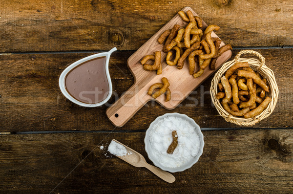 Churros with chocolate dip - Streed food, deep fried Stock photo © Peteer