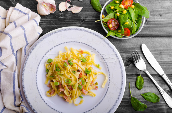 Italian pasta with spring onion and bacon Stock photo © Peteer