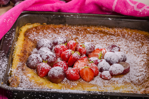 Pancake cooking in a plate with fruit Stock photo © Peteer