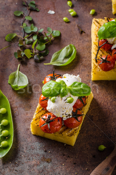 Grilled polenta with tomatoes Stock photo © Peteer