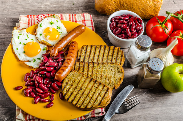 English breakfast - garlic toast, fried egg, beans and English breakfast, toast, egg, beans, sausage Stock photo © Peteer
