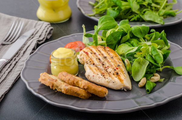 Grilled chicken with salad and nuts Stock photo © Peteer