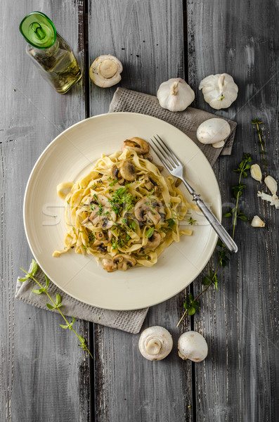 Stock photo: Fettuccine with garlic and mushrooms