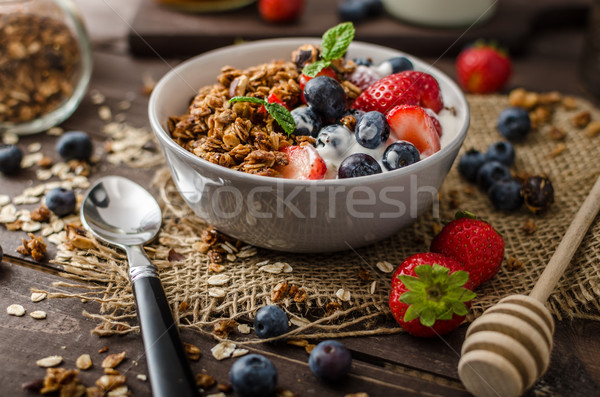 Stock photo: Yogurt with baked granola and berries in small bowl