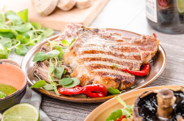 Grelhado carne de porco risotto rústico restaurante tabela Foto stock © Peteer