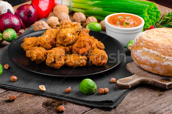 Spicy breaded chicken wings with homemade bread Stock photo © Peteer