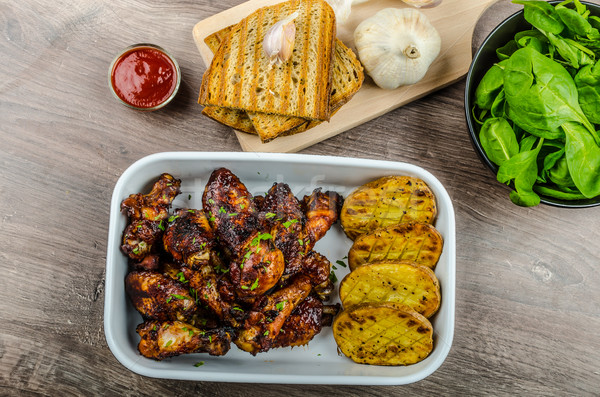 Stock photo: Sticky chicken wings with garlic panini bread