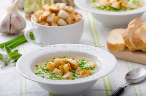 Garlic soup with croutons, spring onions and chives Stock photo © Peteer