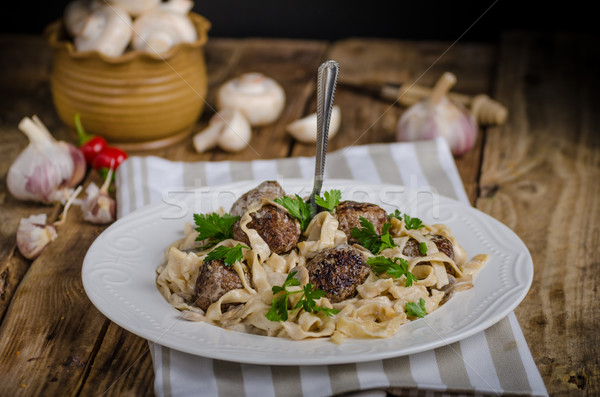Homemade tagliatelle with meat balls Stock photo © Peteer
