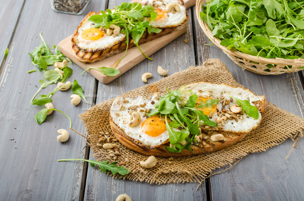 Village bread, fried eggs Stock photo © Peteer