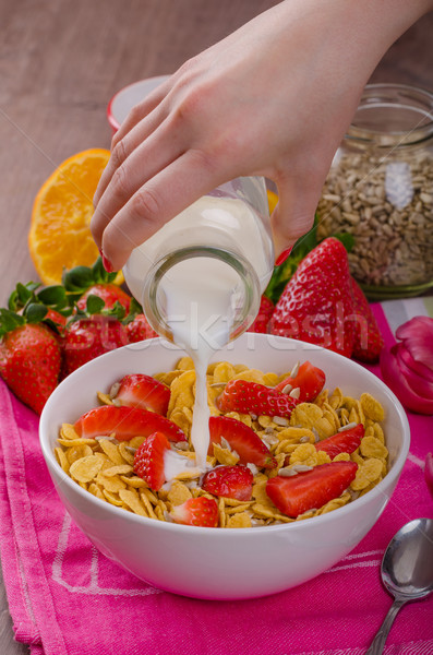 Healthy breakfast cornflakes with milk and fruits Stock fotó © Peteer