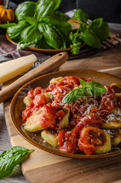 Roasted gnocchi with tomato souce Stock photo © Peteer