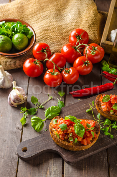 Italian bruschetta with roasted tomatoes and garlic Stock photo © Peteer
