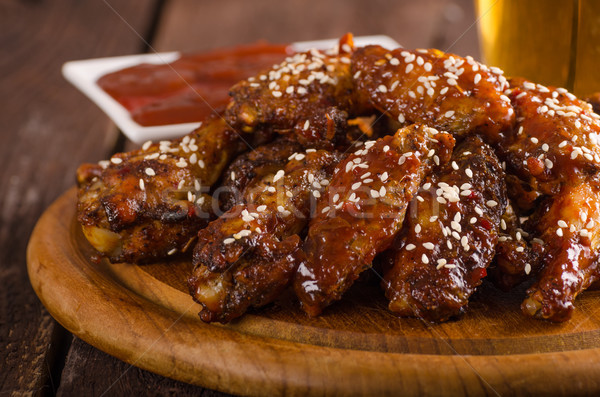Grilled chicken wings with hot sauce Stock photo © Peteer