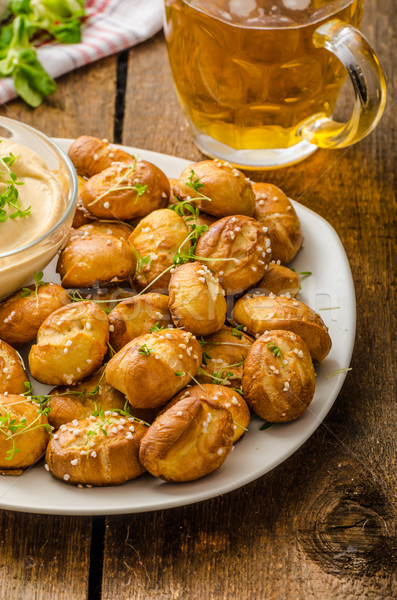 Pretzel rolls with cheese dip Stock photo © Peteer