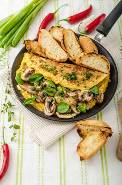 Omelet with mushrooms, lamb's lettuce, herbs and chilli Stock photo © Peteer