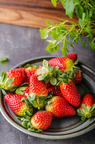 Strawberries fresh pick up Stock photo © Peteer