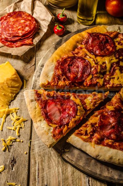 Rustik salam pizza çedar peynir chorizo Stok fotoğraf © Peteer