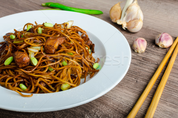 Crisp noodles with soy souce Stock photo © Peteer
