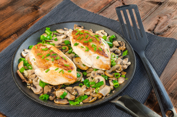 Chicken breast with mushrooms and spring onions on pan Stock photo © Peteer