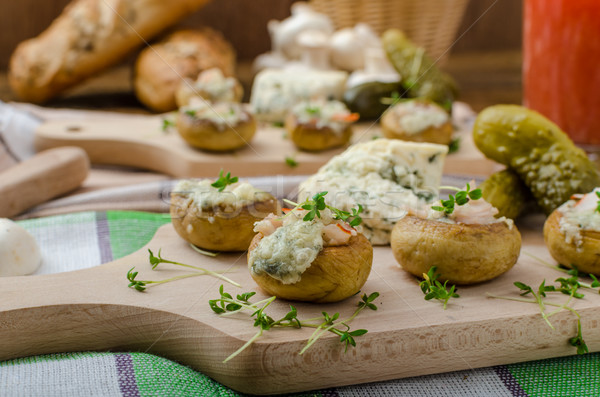 Stock photo: Mushrooms stuffed with cheese