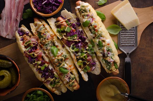 Tüm sığır eti sosisli sandviç lahana domuz pastırması peynir Stok fotoğraf © Peteer