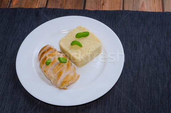 Frango grelhado peito couscous manjericão mesa de madeira textura Foto stock © Peteer