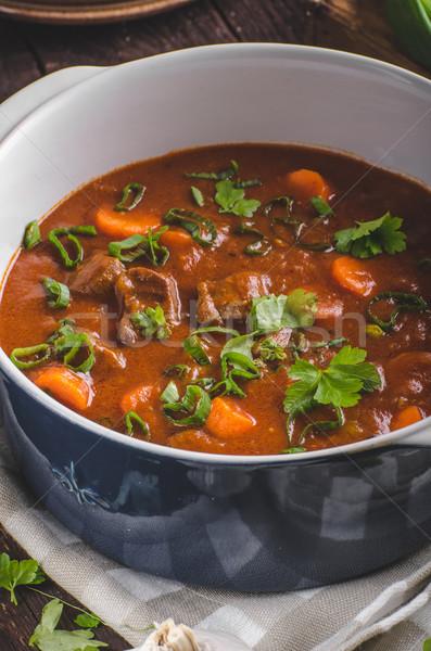 Foto stock: Carne · guisada · cenouras · comida · fotografia · ervas · dentro
