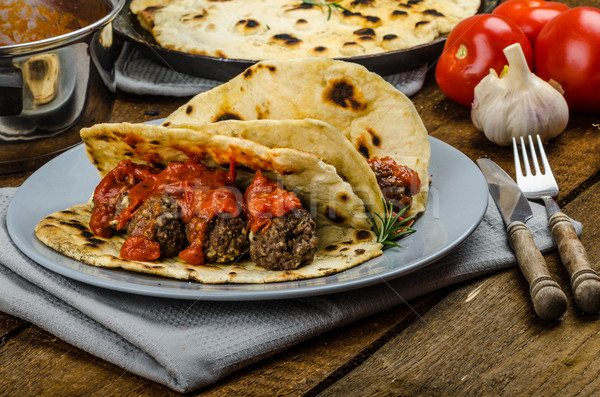 Indian naan with meatballs and tomato sauce Stock photo © Peteer