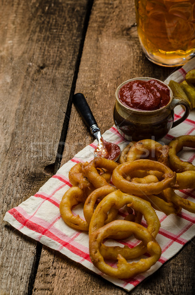 Onion rings, hot dip, french fries and Czech beer Stock photo © Peteer