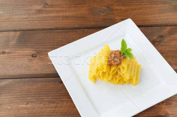Penne Bolognese on wood table Stock photo © Peteer