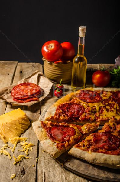 Rústico salami pizza cheddar queso chorizo Foto stock © Peteer