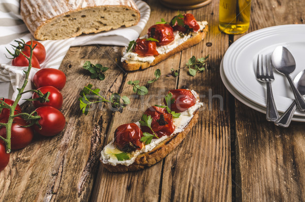 Homemade sourdough bread with roasted tomatoes Stock photo © Peteer